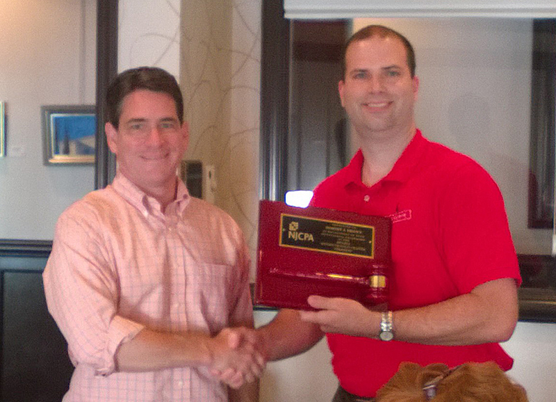Monmouth/Ocean Chapter President Mike Adago (right) presents Rob Brown, immediate past president, with plaque to commemorate his service to the chapter.